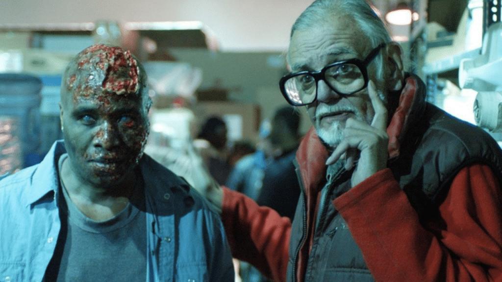 George Romero con un zombie durante rodaje